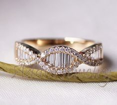 Gorgeous baguettes. I like them for the wedding ring. Only in white gold only & with scroll work.