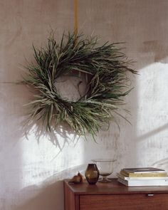"""This minimalist ring is fashioned solely from branches of grevillea, an Australian native commonly grown on the U.S. West Coast. """"It's one of my favorite plants for wreaths,"""" says Thompson. """"I love how the narrow leaves are green on one side and silver on the other, which creates an ombre effect."""""""