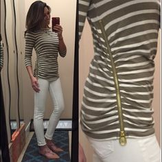 Michael Kors shirt A must have style and color this year. Olive green/white. I love it paired with white jeans. It's effortlessly classic/chic. It has a boat neck, 3/4 length sleeves and ruching on both sides. The left side has a gold functional zipper as well. Size PS. Euc Michael Kors Tops Tees - Long Sleeve