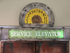 Magalie Sarnataro's prop Halloween 2017 The Hollywood Tower Hotel Service elevator sign, foam board, paint , cricut letters and numbers... Lights inside and collapsible for storage