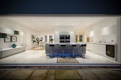 Bi folding doors leading into Kitchen and open plan living room/ dining area