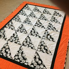 Volleyball quilt for my granddaughter.  Her school colors are black and orange