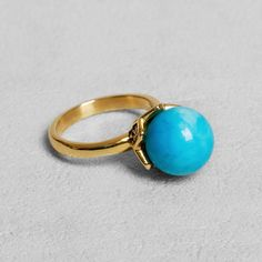 Petit Sesame   Ip gold oliah turquoise ring   Designed by Petit sesame   $16.00   Gold ip coated stainless steel ring set with a natural turquoise gem