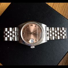 Ladies Rolex – oyster perpetual motion Ladies Rolex – oyster perpetual motion with rose-colored face.  In excellent condition. Barely worn.  Original price $4650 Rolex Jewelry Perpetual Motion, Rolex Oyster Perpetual, Oysters, Bracelet Watch, Shop My, Rose, Lady, Color, Accessories