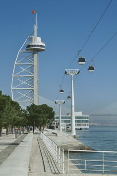 The cable car and the Tagus Tower. Enter the cable car and experience the feeling of seeing lisbon and the natural beauties that surround this city Portugal Destinations, Portugal Places To Visit, Europe Destinations, Nature Photography, Travel Photography, World Cities, Spain And Portugal, Beautiful Places, 1