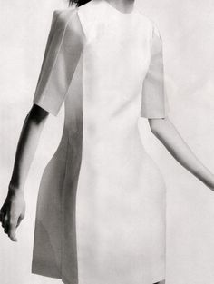 Dress with boxy silhouette blending sharp folds & curved shapes; sculptural 3D fashion construction // Calvin Klein