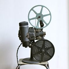 Bell And Howell Film Projector Bell by Trampoline Vintage: I want to project old photos of the building my Café is in onto the wall