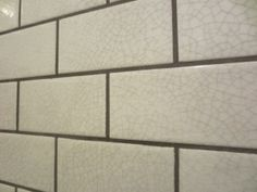 Close up of my favorite -- the crackled glaze tile with gray grout.