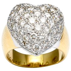 Rene Lewis. Lovely, heart ring featuring 48 diamonds weighing approximately 2.50 carats, crafted in 18k gold, signed Rene Lewis.Circa 2000s