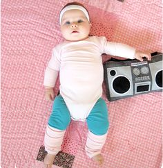 From 80's aerobic instructor to a perfectly sprinkled doughnut, here you'll find 10 ah-mazing DIY baby costumes, all of which start with something you have dozens of lying around your home. You guessed it, the universal onesie!