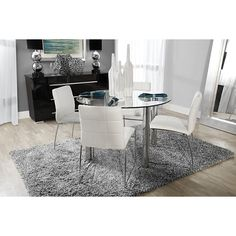 300.00 Set includes: Round table and four side chairs    Update your dining space with the contemporary Napoli dining table set. Enjoy the aesthetic beauty of chrome and glass, plus the comfort of tufted, upholstered seats as you reinvent your home's interior with the simple elegance of modern design.