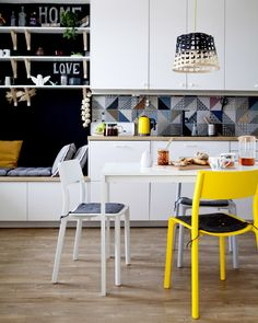 Bold accent colours make all the difference in an open shared space such as the kitchen/dining area.