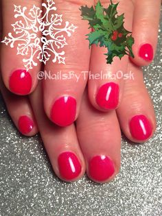 Soft red nails with a hint of pink and purple shimmer in it - giving the nails a happy glow