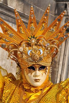 The Queen of Venice...a beautiful sunburst crown in a golden mask and costume.  See the tiny celestial elements in the headdress?  A smiling sun, clouds, the progress and phases of the moon across the starbursts?  Exquisite!