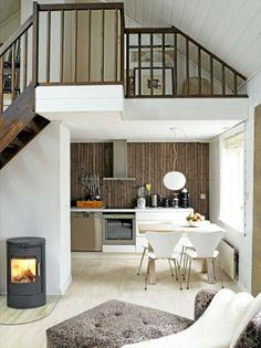 as usual, love the dark wood with the white. also love the slanted wood ceiling painted white and the little nooks.