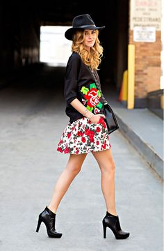 Black floral sweatshirt with white floral skirt and black hat