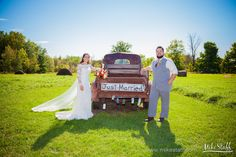Smiling bride and groom with old pickup truck with 'Just Married' sign  #Michiganwedding #Chicagowedding #MikeStaffProductions #wedding #reception #weddingphotography #weddingdj #weddingvideography #wedding #photos #wedding #pictures #ideas #planning #DJ #photography #bride #groom