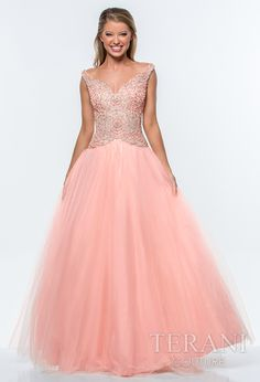 Tulle prom ballgown with decollete neckline and pearl and sequin circular embellishments over the bodice and onto the high hip, the dress is finished with a full tulle skirt