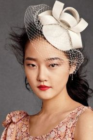 Coil hat with birdcage veil by BHLDN. I adore a good headpiece.