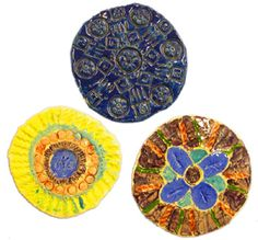 4th Grade Art with Mrs. Brown Ceramic Clay art lesson project radial symmetry trivets (glue thin cork to bottom afterward)