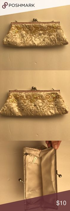 Ivory Beaded and Sequin Evening Purse 10 inch Beautifully beaded evening purse. Measures 10 inches x 4 inches. No missing beads and sequins Bags Clutches & Wristlets