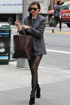 Miranda Kerr....I like black tights which are transparent