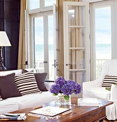 Lovely doors, view, everything. I love how inviting and airy everything looks.