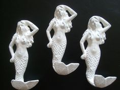 iron maiden - mermaid hooks these would look nice hung by the pool to hold towels and looking so cute at the same time. csa