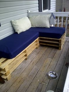 My new pallet bench!! Not quite finished. Gonna be a little longer. It's made from free pallets and crib mattresses that I bought on Craigslist. Super comfy!!