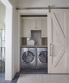 A beautiful hidden laundry room nook designed by #GeoffChickandAssociates. via: @the_real_houses_of_ig.