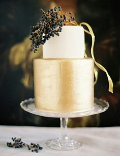 {Gorgeous, Two Tier Wedding Cake With Bottom Tier Sprayed Metallic Gold, Top Tier Ivory, Featuring A Few Sprigs Of Dark Blue Privet Berry Tied With Gold Ribbon································}
