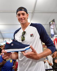 John Isner (wearing Fila Heritage) checks out their latest special edition tennis shoe.