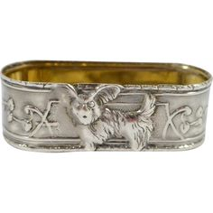 This absolutely exquisite Child's Napkin Ring was designed by Ari D. Norman (AN), in Britain, circa It is sterling silver with a Silver Napkin Rings, Silver Rings, Yorkshire Terrier Dog, Silver Stars, Antique Art, Vintage Silver, Heavy Metal, British, Sterling Silver
