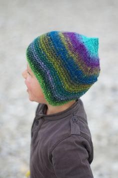 Woolly Wormhead - Quynn - knitting pattern for childs Hat (add yarn braids down the side to tie under the chin to keep the hat on little heads)