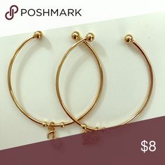 Gold bangle style bracelet set (NWOT) Cute set of two gold colored bangles with charms. One bangle has a heart charm and the other had a musical note. These are new without tags- purchased these new from a boutique without tags and never worn. Jewelry Bracelets