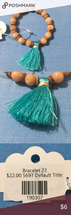 Tassel bracelet Earth tone beads with aqua colored tassel stretch bracelet. Jewelry Bracelets