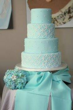 Tiffany blue wedding cake with bows and white detailing