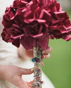 Awesome Harry Potter bouquet! I don't know if I could bring myself to cut up a book... but this is way cool.
