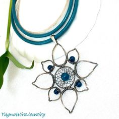 Silver Flower Pendant  Leather Cord Necklace  by YagnaWireJewelry