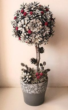 not into green and red here is an alternative. diy christmas pine cone topiary.: