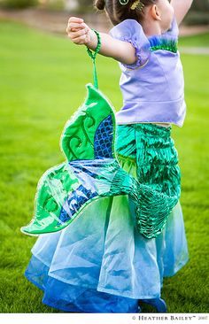 Adorable child-size mermaid costume! I love how the skirt is the water. LOVE. WANT.