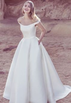 The modern classic. In Mikado new to the 2017 collection, this off the shoulder ball-gown is proof that simplicity is the ultimate sophistication. With a full ballgown skirt and pockets, this is contemporary luxury at it's true finest. Fabric: Mikado Colours available: Ivory and white Sample available instore to try #bridal #weddingdress #cheshire