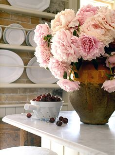 white stoneware, white marble counters; insanely in-love w/these pink peonies in this earthy jug