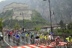 The pack rides with the Fort of Bard in the background during the 14th stage of the Tour of Italy cycling race, on May 19, 2012, in Cervinia. Hesjedal claimed the pink jersey. AFP PHOTO / LUK BENIESLUK BENIES/AFP/GettyImages