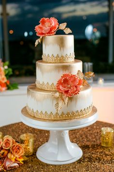Gorgeous coral and gold details on this wedding cake || Photographer:  Set Free Photography || Cake Designer: Kakes by Karen || Selected by Finepointwedding.com