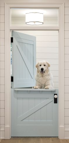 White shiplap frames a blue shiplap dutch door accented with white and black hardware and lit by a black and white scalloped flush mount light. - June 01 2019 at Farmhouse Design, Farmhouse Style, White Farmhouse, Farmhouse Decor, Southern Farmhouse, White Cottage, Farmhouse Ideas, Modern Farmhouse, Open Family Room