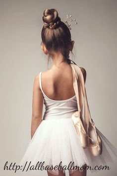 Beautifully captured girl kid in her dance costume. Ballerino dance shoes casually being carried on her little shoulder and the hair style attractive and creates a cute dance costume photo.Incase, you have a daughter you will be able to relate to it better.