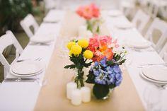 colorful centerpiece ideas - photo by Lara Hotz http://ruffledblog.com/sun-studios-australia-wedding