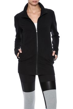 The longer length and cozy fabric make this jacket the perfect piece to wrap up in when your heading to your favorite juice bar for an after-class treat. Featuring thumbholes and pockets.   Yoga Girl Jacket by Lucy. Clothing - Activewear Indiana