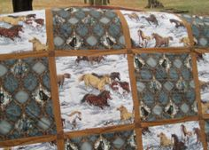 Great fabric combination horse quilt with brown sashing. Great for a big pattern fabric.